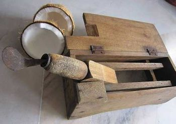 Old traditional coconut grater in south east asia stock image.