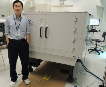 Chu with the award-winning V810 – the world's fastest automated X-ray inspection system.