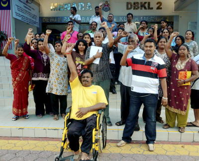 Unhappy lot: About 35 traders gathered at Menara DBKL 2 to show their displeasure against DBKL's new balloting system
