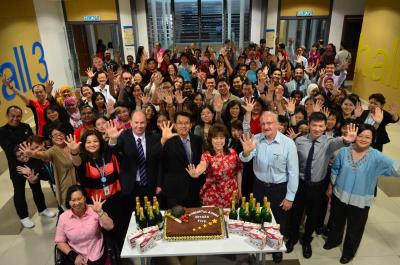 <b>High five:</b> Sunway University culinary students and chef lecturers baked a cake to celebrate the institution's Tier Five status under Setara 2011.