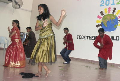 Together: The youths performing a cultural dance that reflects unity.