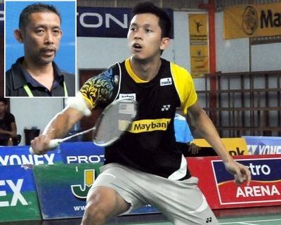 New champion: Misbun Ramdan Mohamed Misbun in action against Chong Wei Feng in the final at the Kedah BA Hall Sunday. Misbun won 13-21, 21-18, 21-18. Inset: Misbun Sidek.