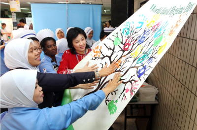 Clean hands nurses putting their hands on the hand hygiene tree as