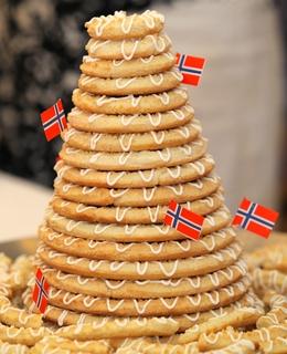 Layered cakes:The kransekake isa layered almondring cake deckedwith ...