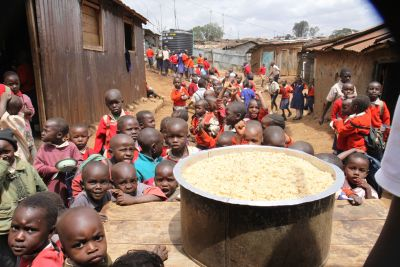 hungry children in long queue for little food