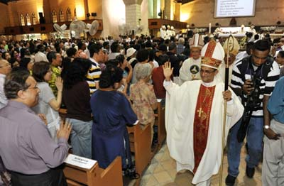Blessed occasion : Bishop Sebastian Francis waving to the congregation after his ordination at St Anne's Church in Bukit Mertajam.