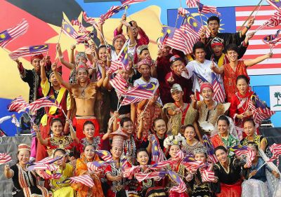 Diverse bunch: Sarawakians, dressed in traditional costumes representing the various races in Sarawak, celebrating Malaysia Day.