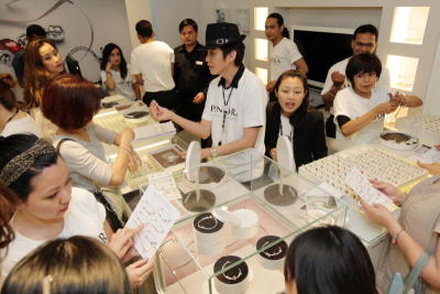 Organised chaos: Customers checking out the lastest jewellery at Pandora's new branch at Mid Valley.