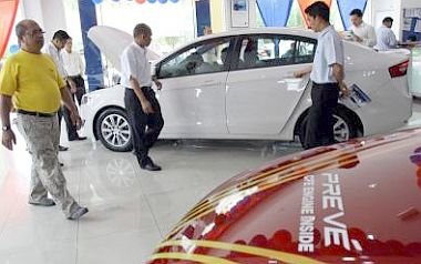 People looking at the Proton Preve. Proton may introduce a five-door hatchback variant of the Preve.