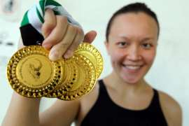 My golden haul: Siow Yi Ting shows off the medals she won during the Malaysian Open Swimming